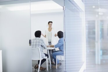 Businesswoman leading conference room meeting - HOXF03484