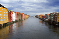 Nidelva river amidst houses against cloudy sky - CAVF45828