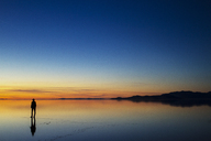 Silhouette woman standing at beach during sunset - CAVF45867