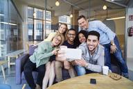 Happy business people talking selfie in office - CAVF47183