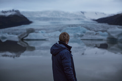 Rear view of man looking at glaciers - CAVF47339