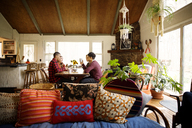 Friends having coffee in living room at home - CAVF47855