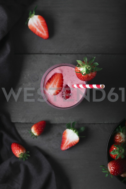 Glasses of strawberry smoothie and strawberries on dark wood - RTBF01205