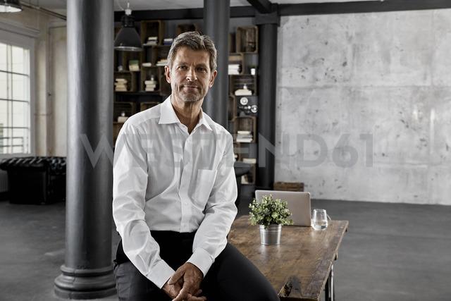 Portrait of mature businessman in loft office - PDF01595