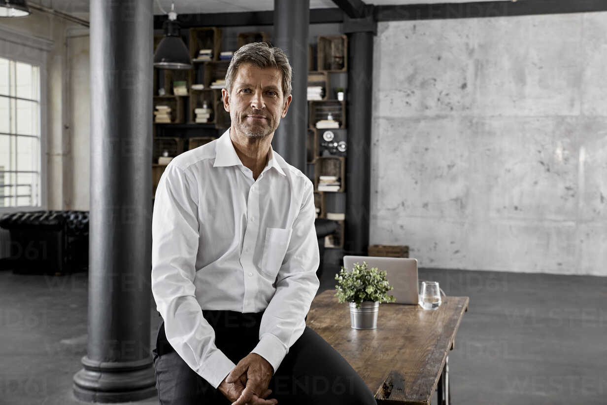Portrait of mature businessman in loft office - PDF01595 - Philipp Dimitri/Westend61