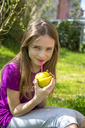 Portrait of smiling girl drinking Strawberry Smoothie in garden - SARF03671