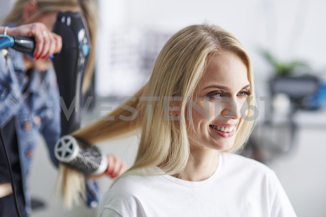 Portrait of happy woman at the hairdresser's - ABIF00357