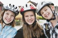 Three girls with bikehelmet - MASF06932