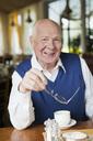 Elderly man holding glasses - MASF07028