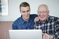 Elderly man and guy with laptop - MASF07037