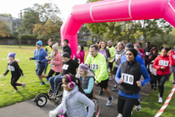 Runners running at charity run in park - CAIF20329