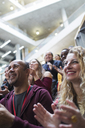 Smiling people clapping in conference audience - CAIF20422