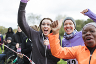 Enthusiastic female spectators cheering at charity run - CAIF20470