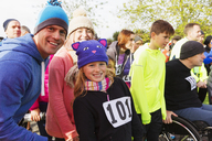 Portrait smiling family runners at charity run - CAIF20491