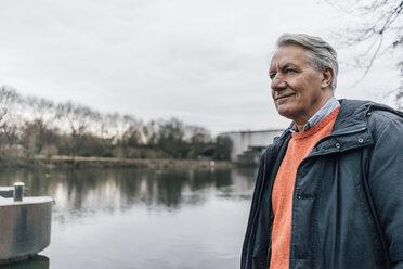 Senior man at the riverside looking sideways - GUSF00661