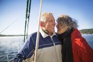 Cheerful senior couple in yacht on sea against clear sky - CAVF48165