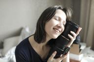 Woman enjoying her new lens - KMKF00231