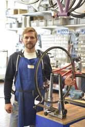 Bicycle mechanic in his repair shop, portrait - LYF00818