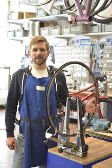 Bicycle mechanic in his repair shop, portrait - LYF00818