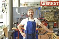 Bicycle mechanic in his repair shop, portrait - LYF00830