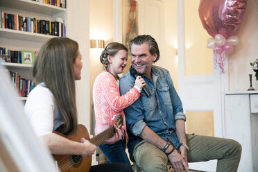 Happy family making music together at home - MOEF01083