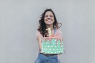 Woman presenting Birthday cake - JPF00309
