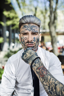 Young businessman with tattooed face, looking at camera - ZEDF01349