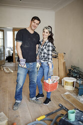 Happy couple renovating their new home - PESF01079