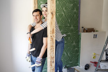 Happy couple renovating their new home - PESF01085