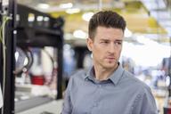Portrait of man in factory looking sideways - DIGF04011