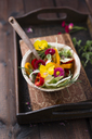 Bowl of mixed salad with herbs and edible flowers - MYF02035