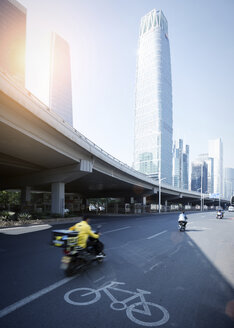China, Beijing, High-rise building and traffic on road - SPPF00023