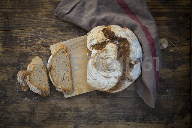 Homemade sourgough rye bread on chopping board - LVF06910