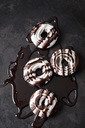 Four meringue pastries with chocolate sauce - CSF29085