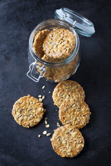 Glass of granola cookies on dark ground - CSF29127