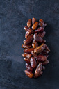 Dried dates on dark ground - CSF29145