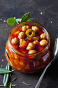 Glass of chick-pea stew with green olives - CSF29148
