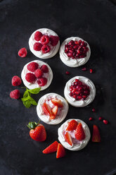 Meringue pastries garnished with whipped cream, berries and pomegranate seed - CSF29169
