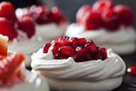Meringue pastry garnished with whipped cream and pomegranate seed - CSF29172