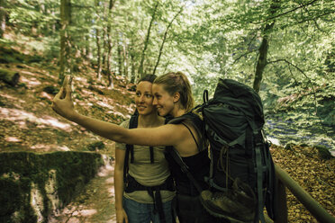 Two young women on a hiking trip taking a selfie - GUSF00742