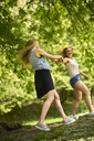 Two best friends dancing together in nature - BEF00003