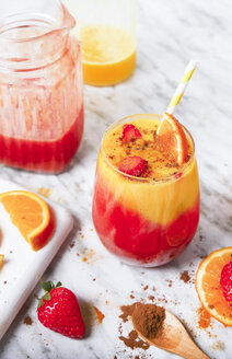 Strawberry and orange smoothie with curcuma and cinnamon on marble - RTBF01241