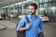 Young businessman with backpack on the go - DIGF04122