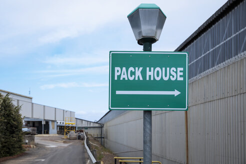 Sign for pack house at lamppost - ZEF15402
