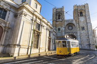 Portugal, Lisbon, typical yellow tram in front of the Cathedral - WPEF00216