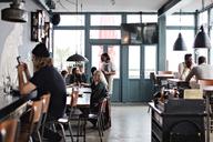 Multi-ethnic people sitting at restaurant - MASF07483