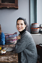 Portrait of smiling woman having brunch at table - MASF07546