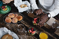 Midsection of young man having brunch at dining table - MASF07564