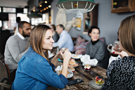 Women having brunch with friends at table - MASF07576