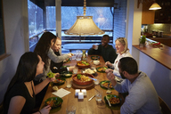 High angle view of multi-generation family enjoying meal at table - MASF07594